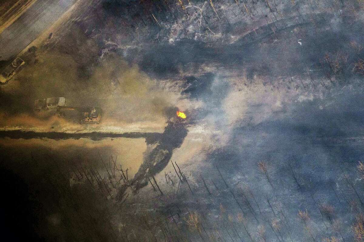 A flame continues to burn after a Monday explosion of a Colonial Pipeline on Nov. 1, 2016 in Helena, Ala. The blast, which sent flames and thick black smoke soaring over the forest, happened about a mile west of where the pipeline ruptured in September, Gov. Robert Bentley said in a statement.