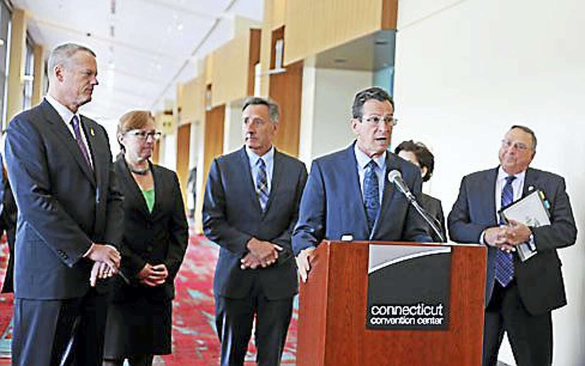 Gov. Dannel P. Malloy speaks to reporters at the Connecticut Convention Center in 2015. Massachusetts Gov. Charlie Baker is at left and Maine Gov. Paul LePage is at right.