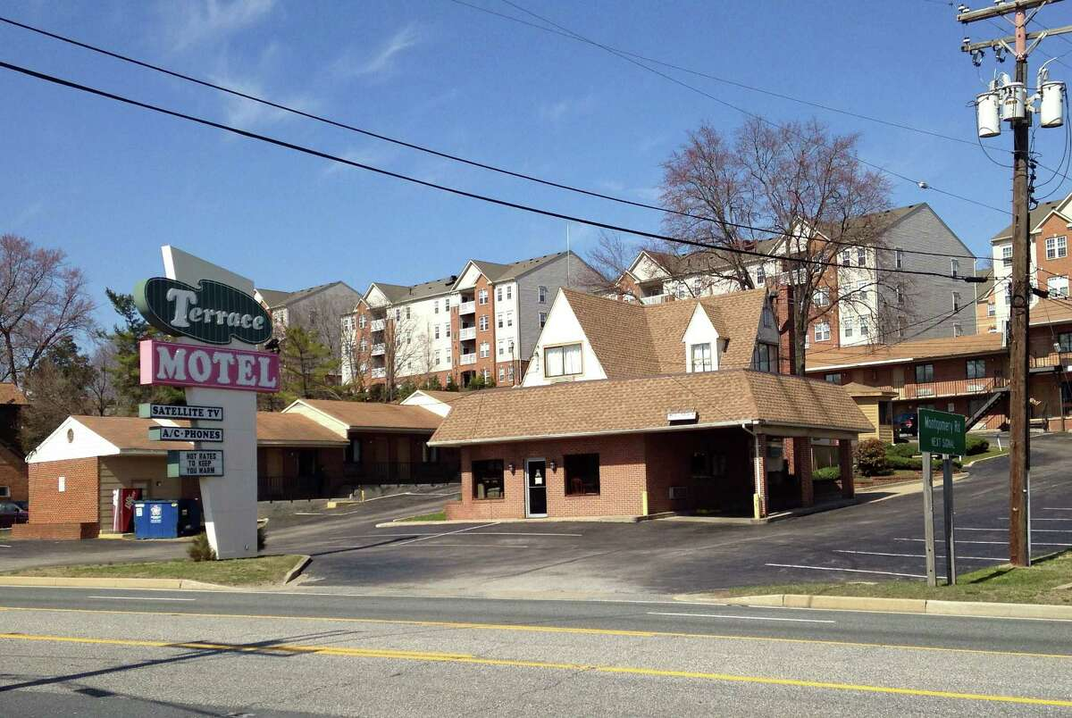 """The entrance to the Terrace Motel sits empty on Tuesday, March 31, 2015 in Elkridge, Md. Police say two cross-dressing men who crashed into a guarded entrance to the National Security Agency on Monday in a stolen car, met the vehicle's owner in Baltimore before heading to the motel to """"party."""" (AP Photo/Meredith Somers)"""