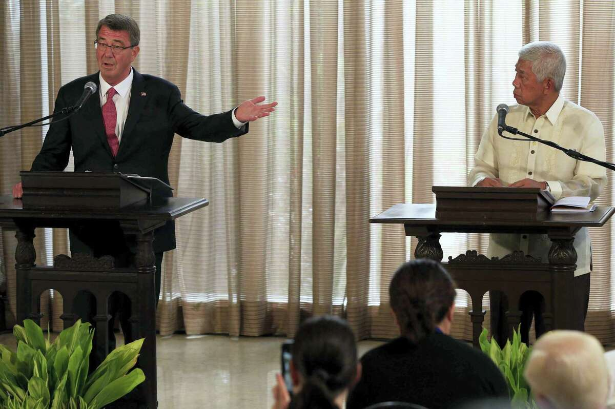 U.S. Defense Secretary Ash Carter, left, answers questions beside his Philippine counterpart Voltaire Gazmin during their joint press conference at the Malacanang presidential palace in Manila, Philippines on April 14, 2016. The United States on Thursday revealed for the first time that American ships have started conducting joint patrols with the Philippines in the South China Sea, a somewhat rare move not done with many other partners in the region.