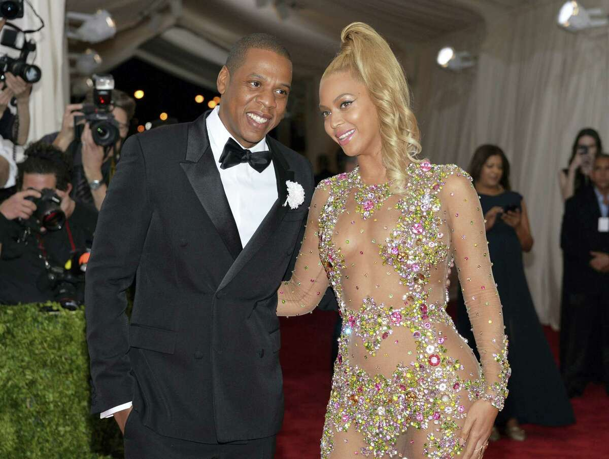 """In this May 4, 2015 photo, Jay Z, left, and Beyonce arrive at The Metropolitan Museum of Art's Costume Institute benefit gala celebrating """"China: Through the Looking Glass"""" in New York. The couple dressed as Barbie and Ken for Halloween in photos posted on Instagram Nov. 1, 2016."""