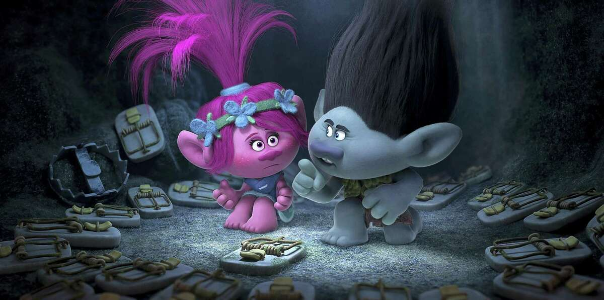 """This image released by Dreamworks Animation shows characters Poppy, left, voiced by Anna Kendrick, and Branch, voiced by Justin Timberlake in a scene from """"Trolls."""""""
