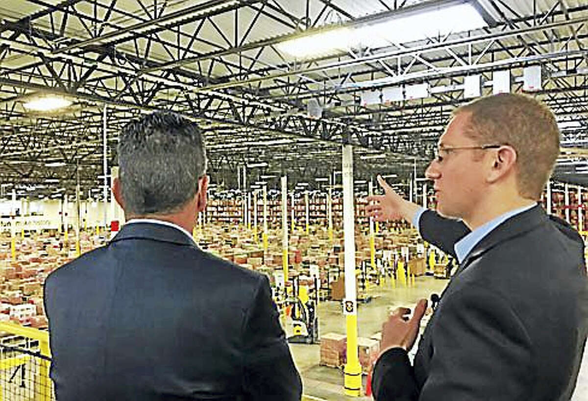Gov. Dannel P. Malloy gets a tour from Eric Powell, general manager of Windsor's Amazon facility.