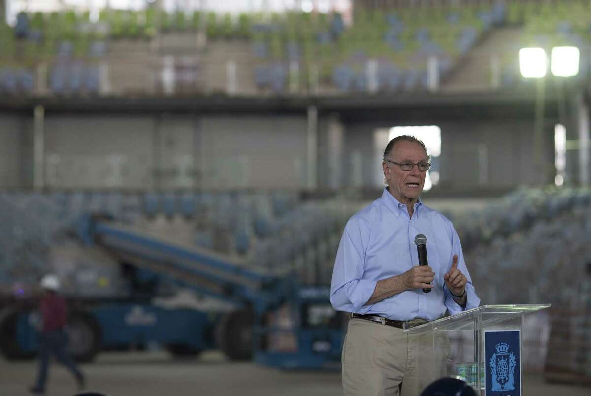 Brazil's Olympic Committee President Carlos Nuzman gives a press conference Wednesday inside a stadium under construction, one year before the Olympics Games start, at Olympic Park in Rio de Janeiro, Brazil.
