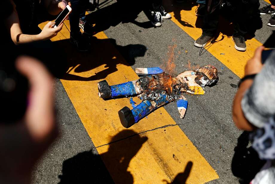 Protesters burn a Donald Trump pinata at 24th and Mission streets in San Francisco in August. Photo: Scott Strazzante, The Chronicle