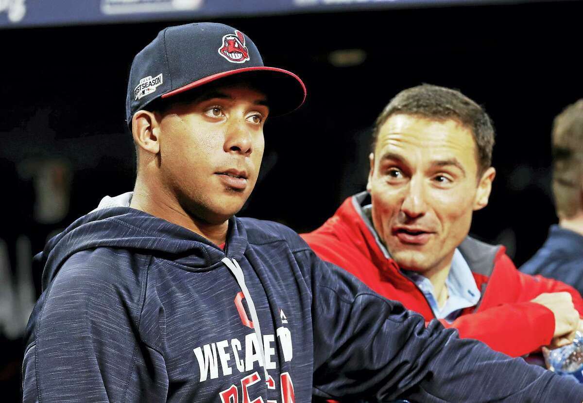 Cleveland Indians team president Chris Antonetti, right, talks with Michael Brantley during practice before Game 1 of the American League Division Series this year.