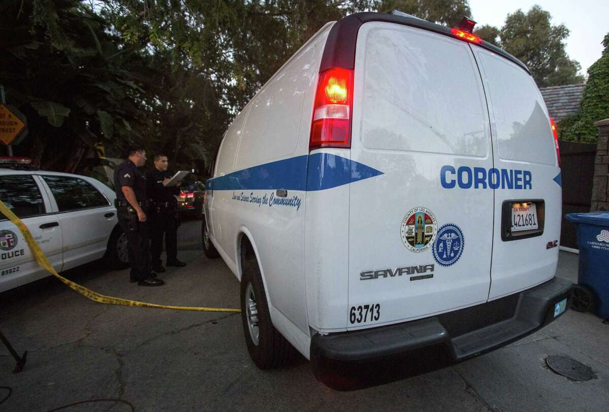 A Los Angeles County Coroner van arrives at a home in the Hollywood Hills area of Los Angeles, Tuesday, March 31, 2015. Police say a man was found dead at the home of Andrew Getty, heir to Getty oil fortune. (AP Photo/Ringo H.W. Chiu)