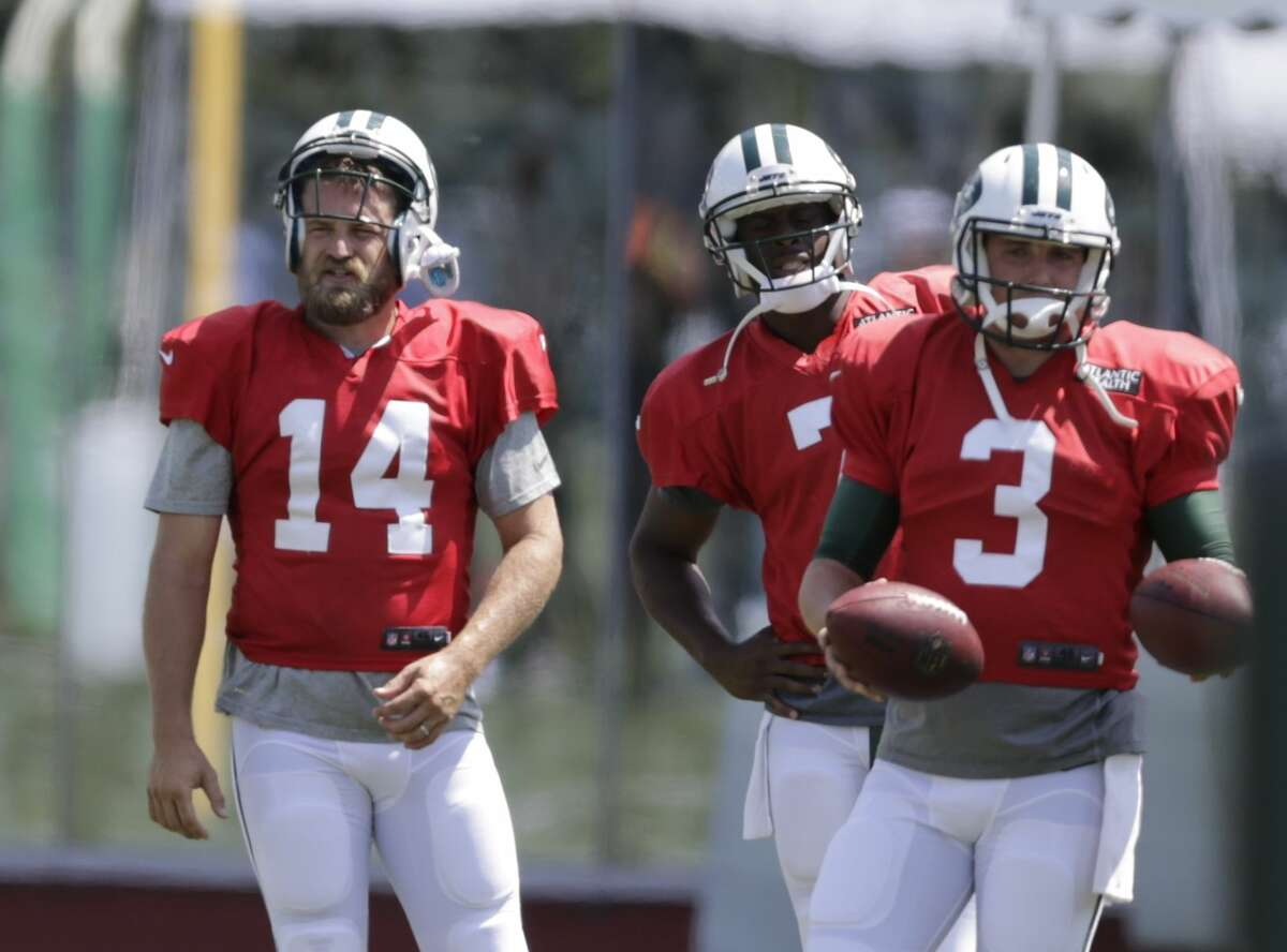 New York Jets quarterbacks Ryan Fitzpatrick (14), Geno Smith (7) and Jake Heaps (3) take part in drills during practice Wednesday in Florham Park, N.J.