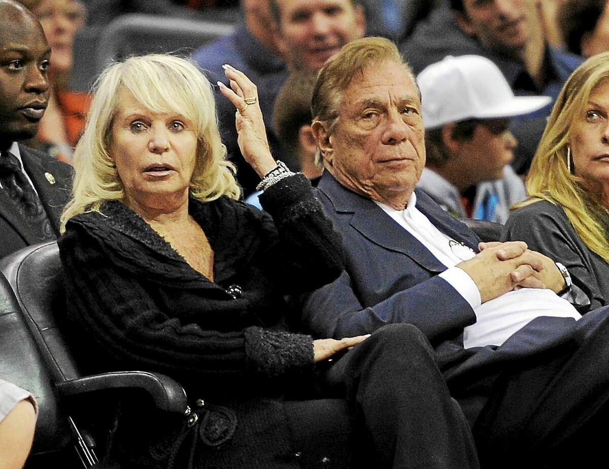 In this Nov. 12, 2010 file photo, Shelly Sterling sits with her husband, Donald, during the Clippers' game against the Detroit Pistons in Los Angeles.