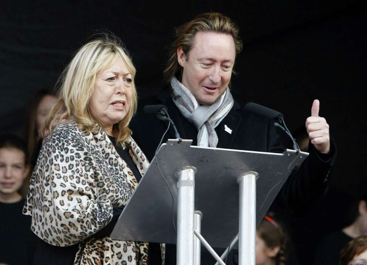 File - In this Oct. 9, 2010 file photo, the son and former wife of singer John Lennon, Julian, right, and Cynthia Lennon, left, at the unveiling of a European peace monument dedicated to the memory of ex-Beatle John Lennon in Chavasse Park, Liverpool, England. Cynthia Lennon passed away on Thursday, April 1, 2015, aged 75, at her home in Mallorca, Spain, following a short but brave battle with cancer. (AP Photo/Tim Hales, File)
