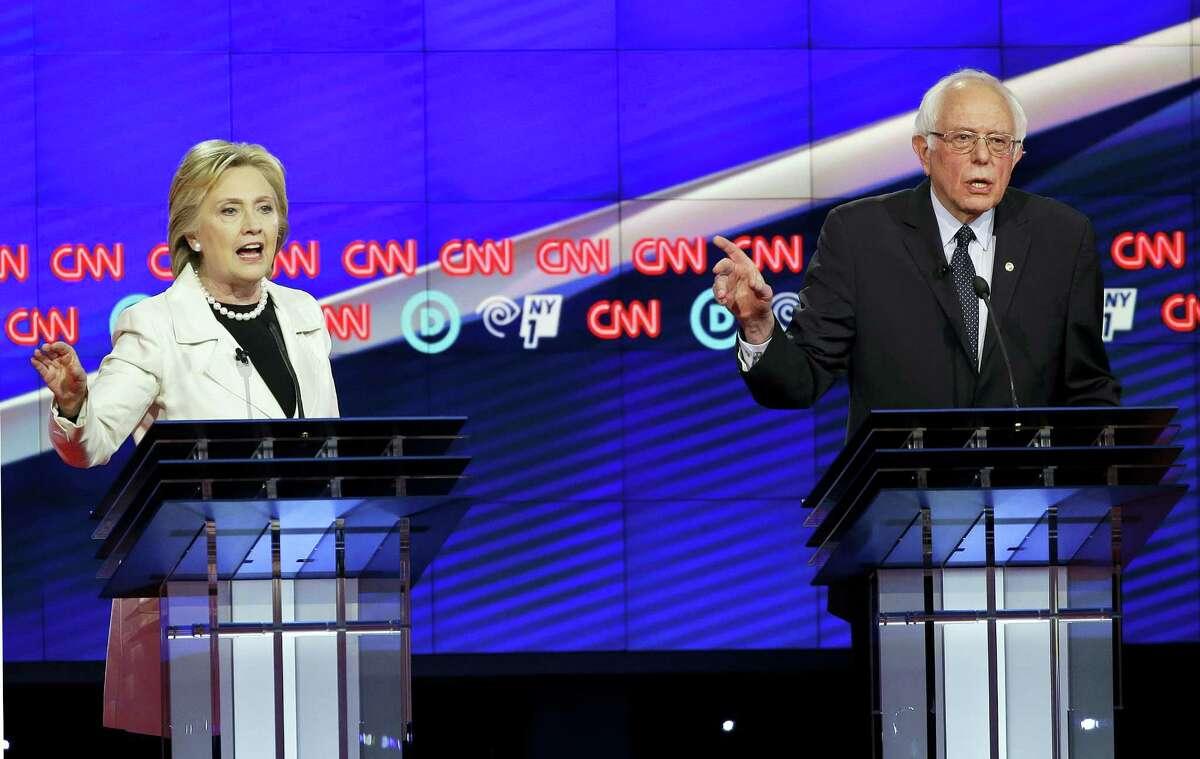 Democratic presidential candidates Sen. Bernie Sanders, I-Vt., right, and Hillary Clinton speak during the CNN Democratic Presidential Primary Debate at the Brooklyn Navy Yard Thursday, April 14, 2016, New York. (AP Photo/Seth Wenig)