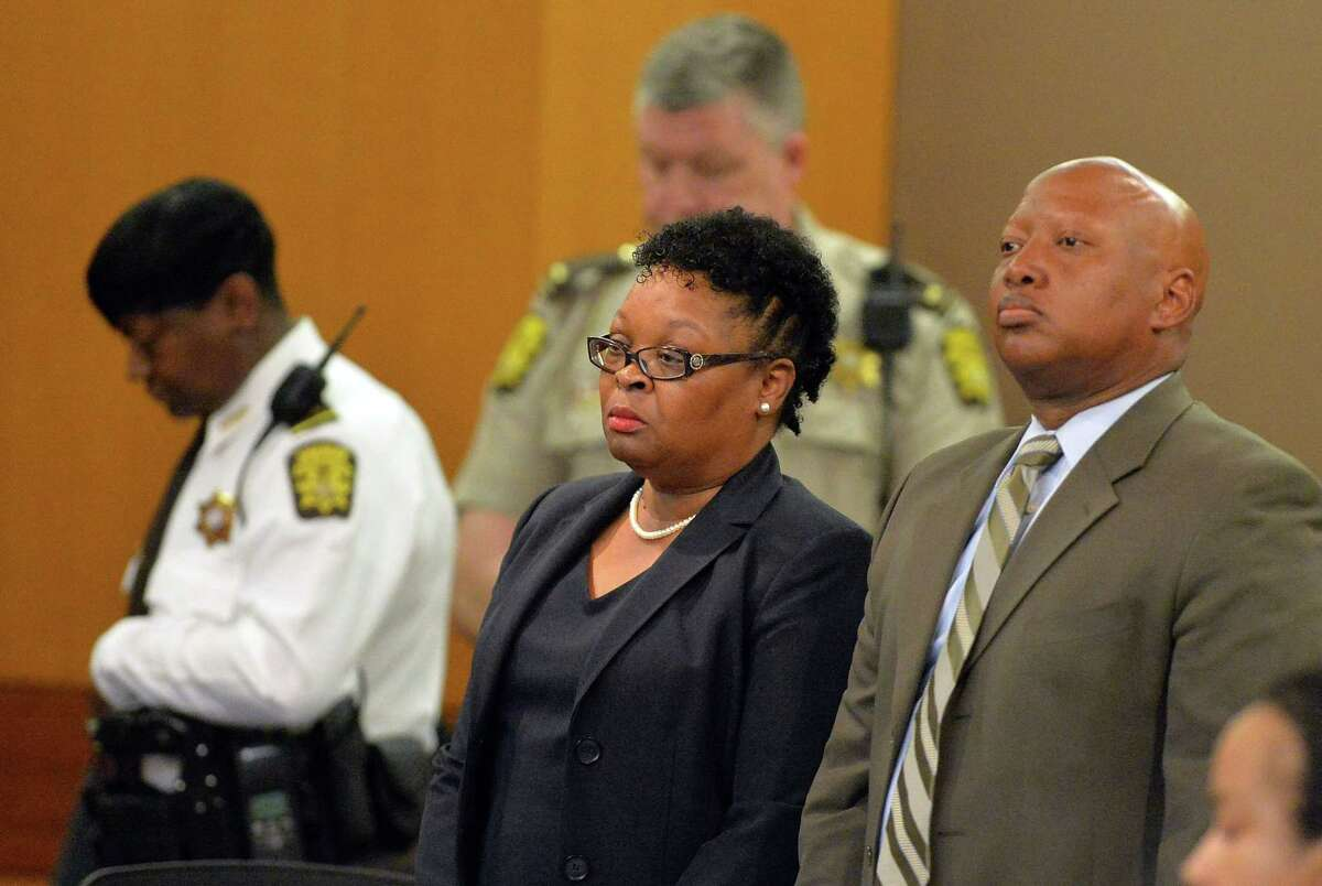 Former Dunbar Elementary teacher Diane Buckner-Webb, center, stands with her defense attorney Kevin Franks after a jury found her guilty in the Atlanta Public Schools test-cheating trial, Wednesday, April 1, 2015, in Atlanta. Buckner-Webb and 10 other former Atlanta Public Schools educators accused of participating in a test cheating conspiracy that drew nationwide attention were convicted Wednesday of racketeering charges.