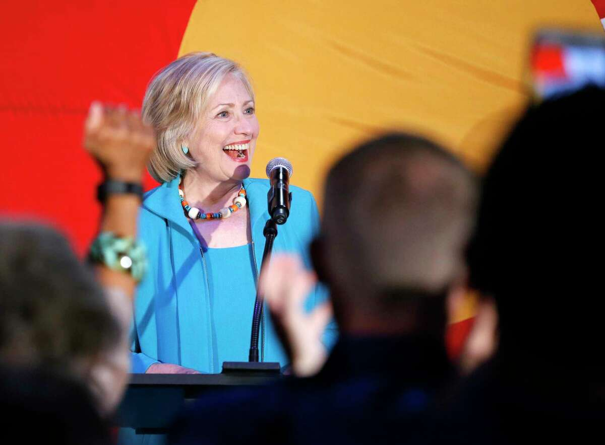 Democratic presidential candidate Hillary Rodham Clinton greets supporters before speaking at a campaign rally at La Rumba, a Denver dance club and restaurant on Aug. 4, 2015.