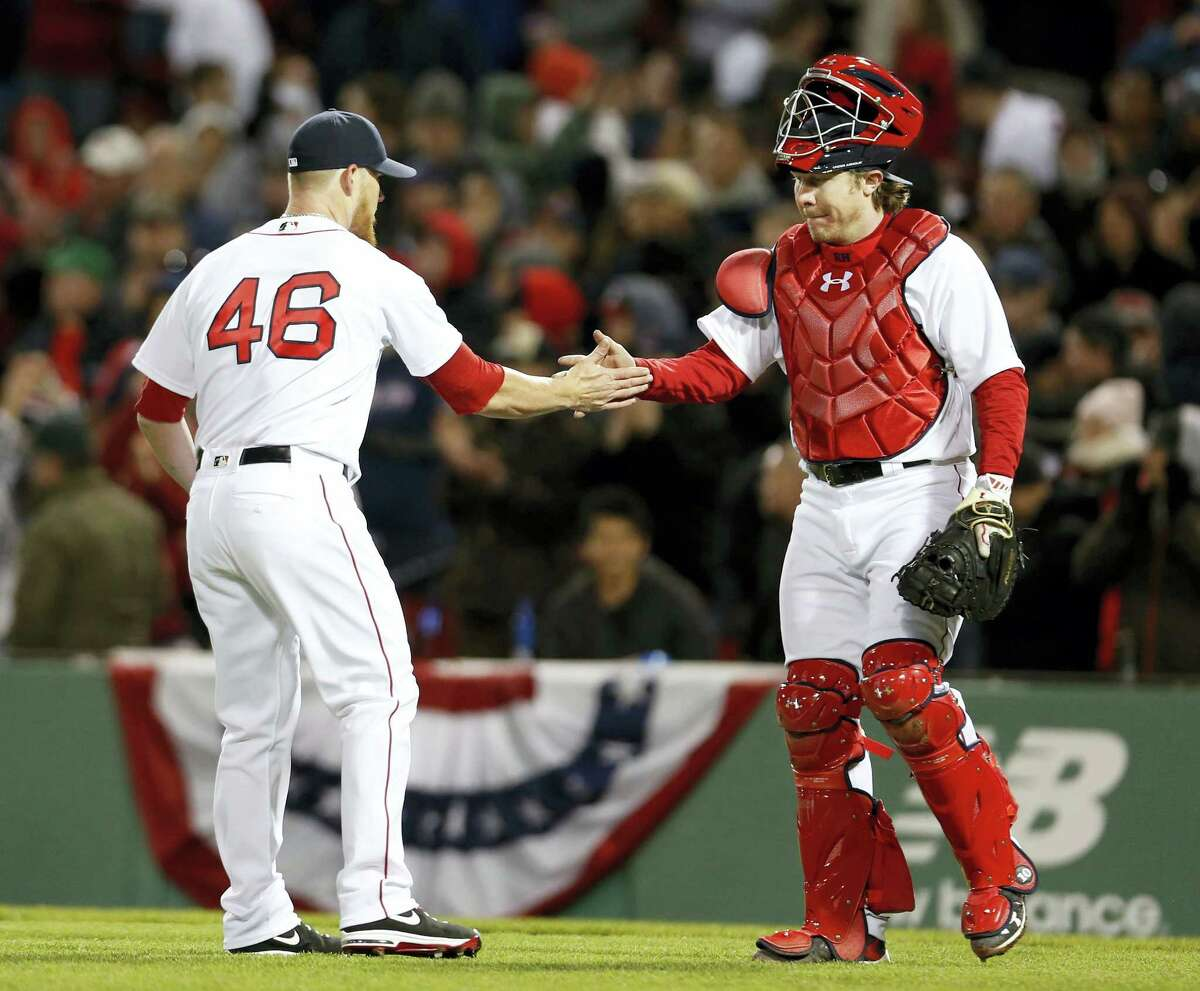 Red Sox catcher Ryan Hanigan congratulates closer Craig Kimbrel after Boston's 4-2 win over the Orioles.