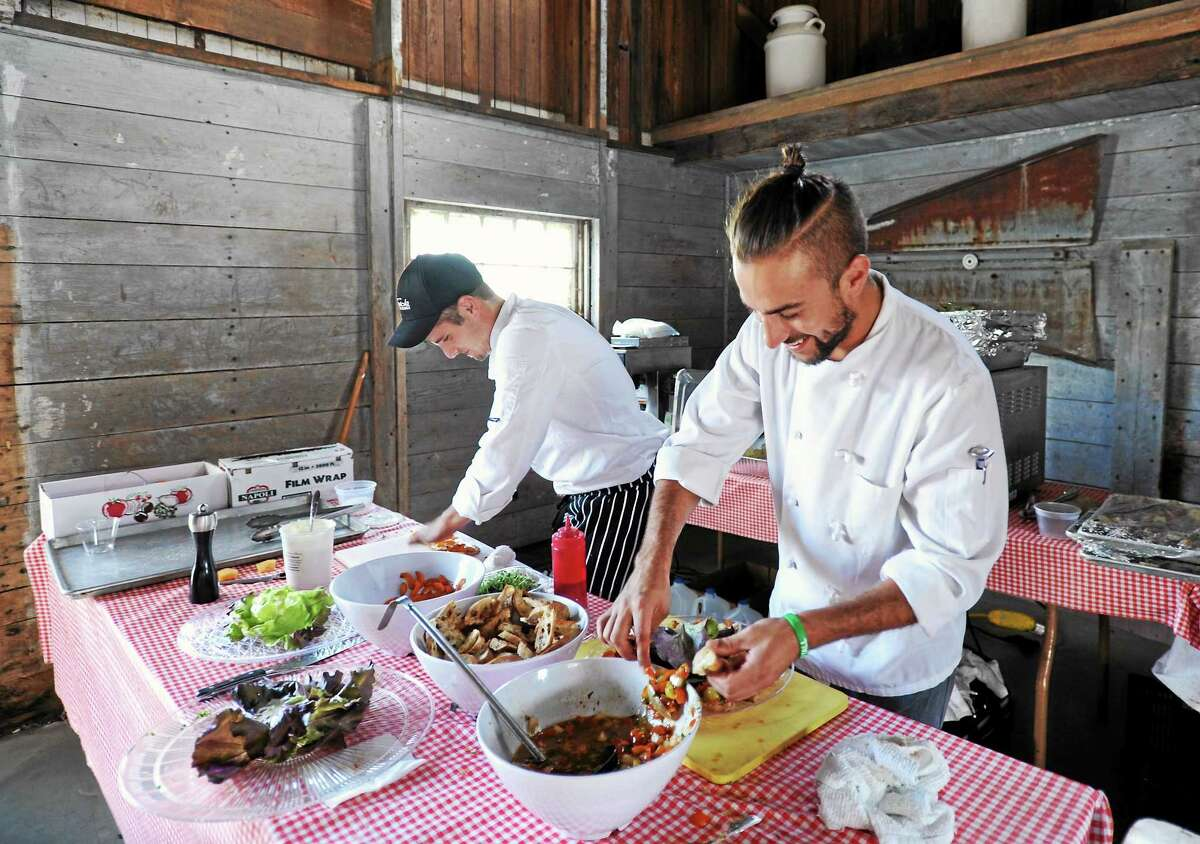Jon Gyles and Julian Focareta prepare food for The Farmer's Table Dinner.