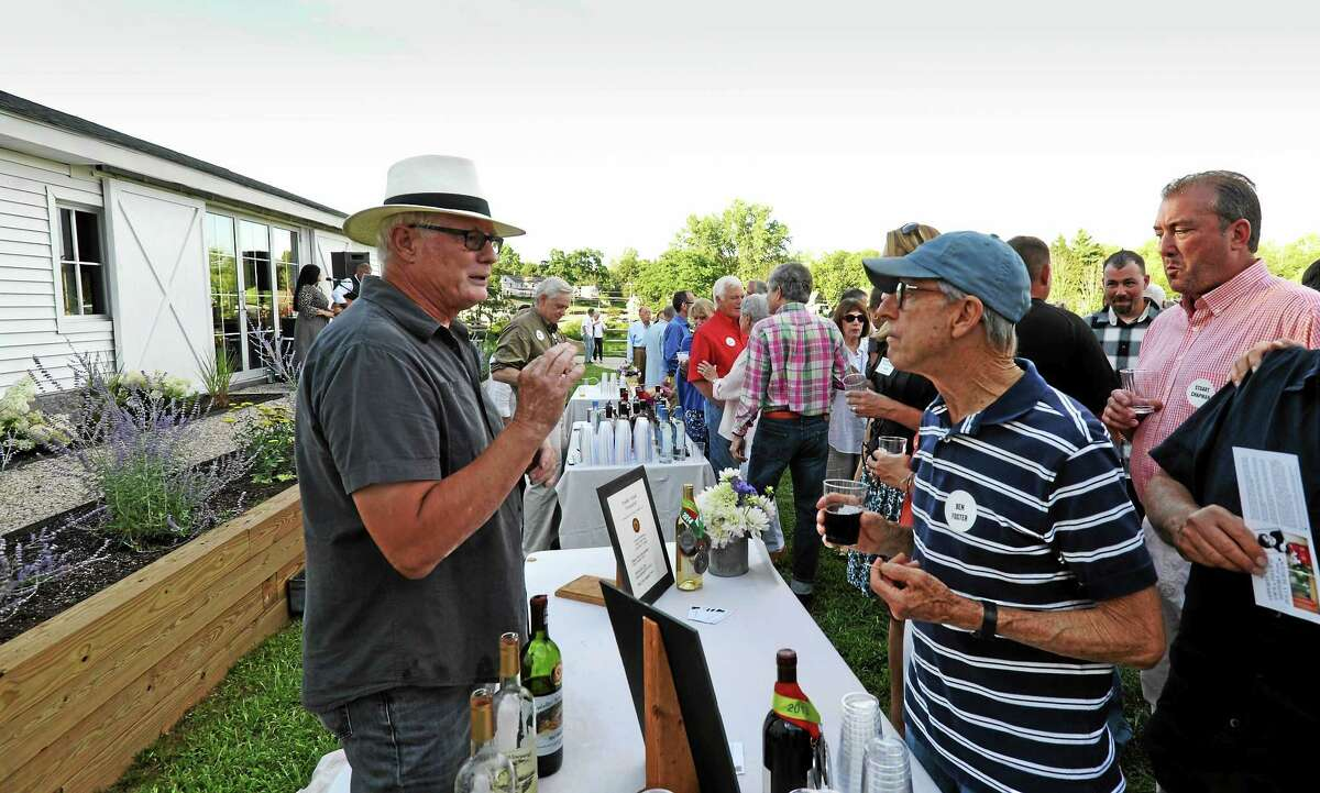James Frey of Walker Road Vineyards talks to Ben Foster, of Litchfield, at the Farmer's Table Dinner event.