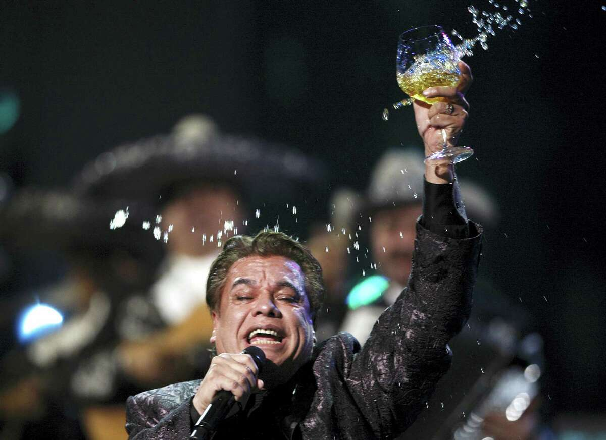 In this Nov. 5, 2009 photo, Juan Gabriel performs at the 10th Annual Latin Grammy Awards in Las Vegas.