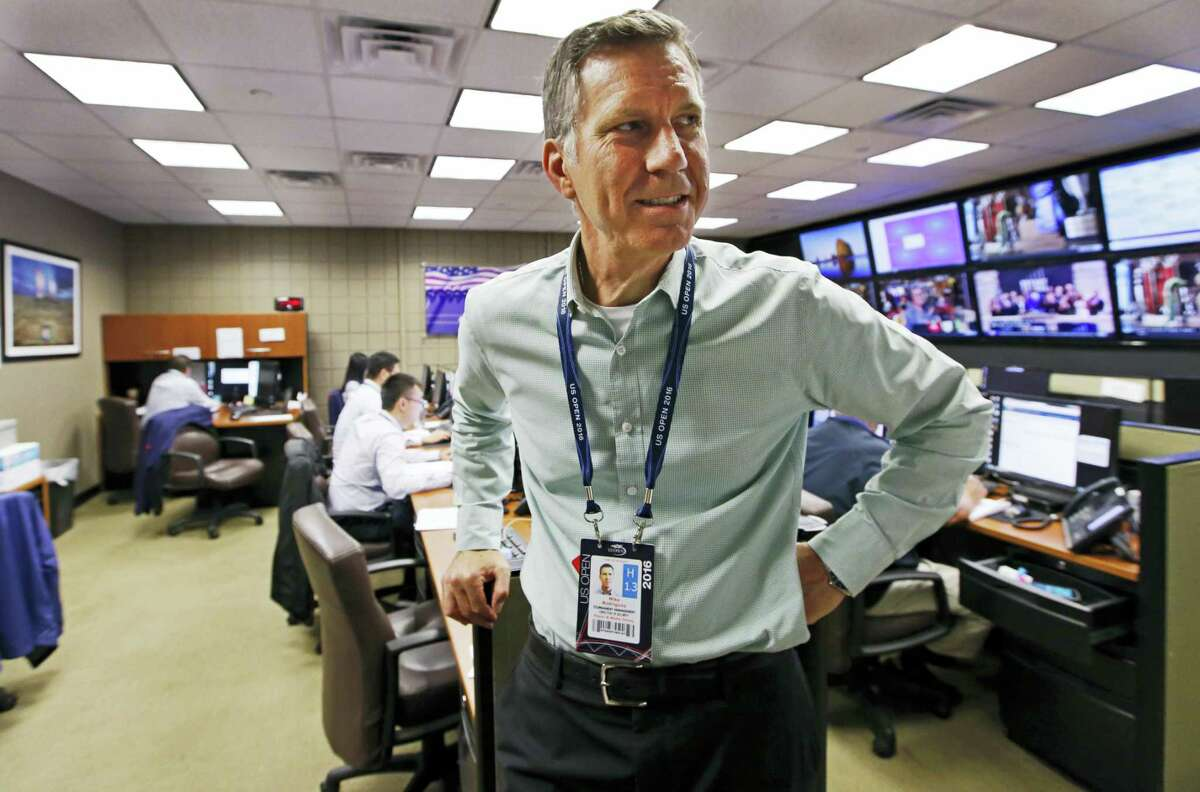 In this Aug. 24, 2016 photo, U.S. Open Tennis Tournament Security director Michael Rodriguez stands inside the tournament's command center inside the Billie Jean King National Tennis Center in New York. With more than 700,000 fans expected, the U.S. Open tennis tournament poses unique security challenges for officials charged with making the grounds safe. Rodriguez oversees a private security force.