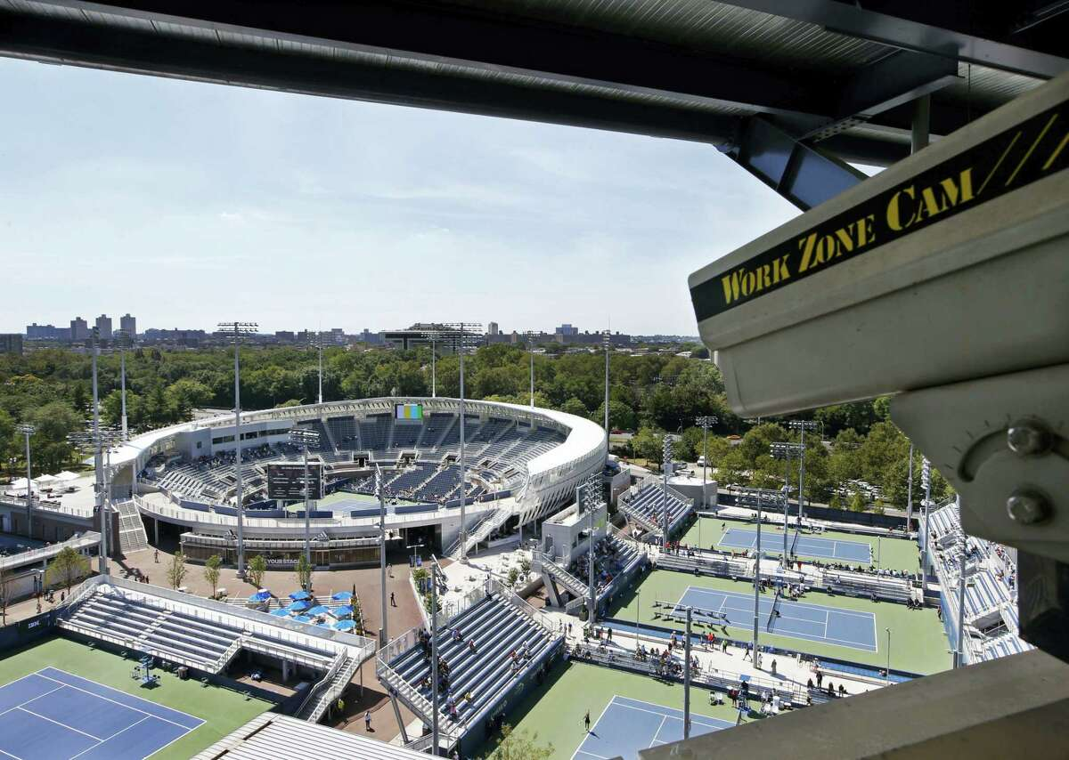 In this Aug. 24, 2016 photo, a closed circuit construction camera peers out at the Grandstand stadium during qualifying rounds at the Billie Jean King National Tennis Center in New York.