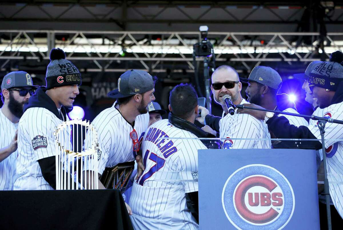 Chicago Cubs' David Ross takes a photo with teammates during a celebration honoring the World Series champions at Grant Park in Chicago on Friday.