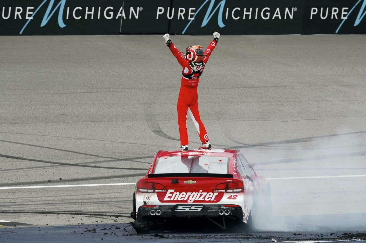 Kyle Larson celebrates winning at Michigan International Speedway on Sunday.