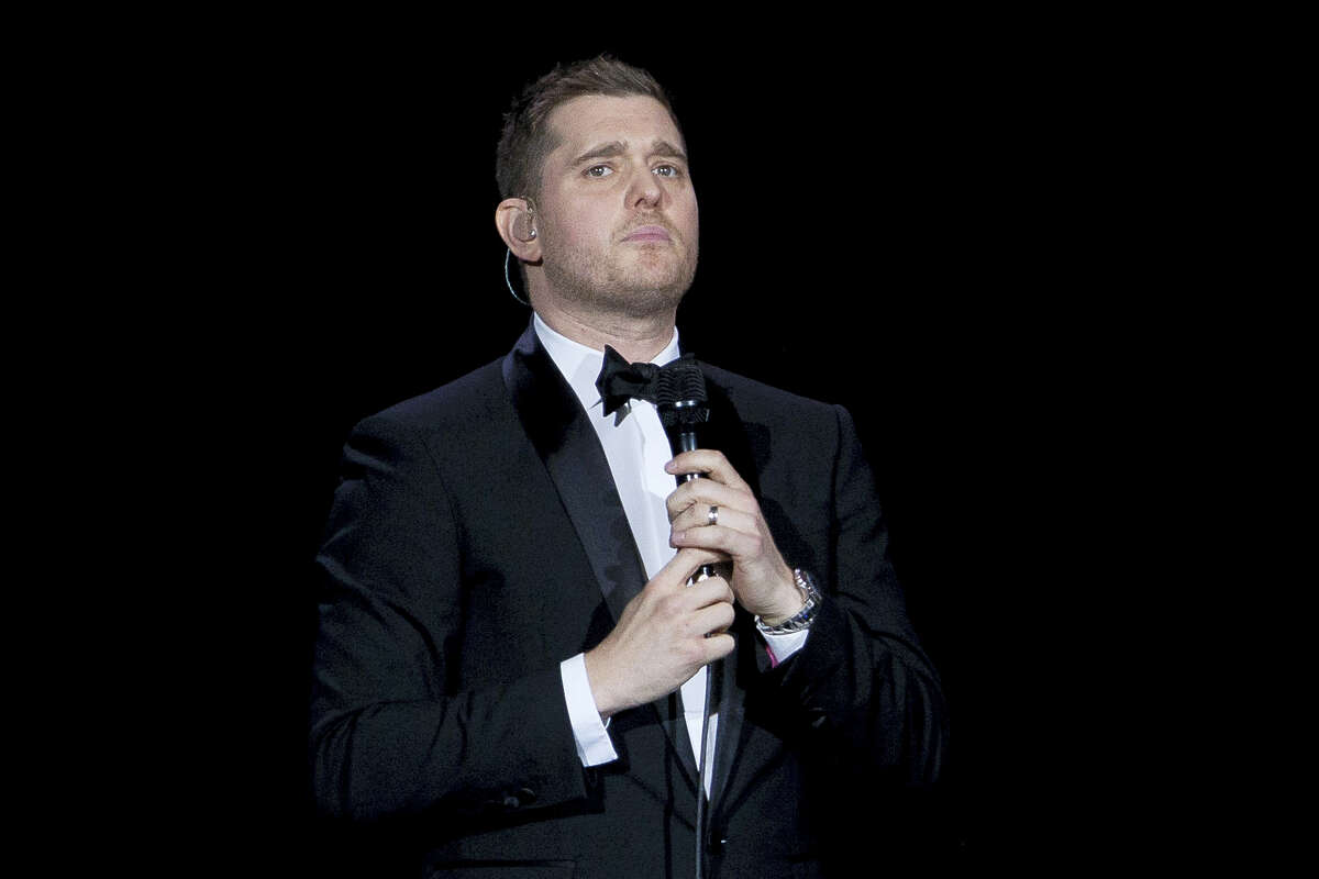 In this Jan. 31, 2014, file photo, Canadian singer Michael Buble performs during his concert at Palacio de los Deportes in Madrid, Spain. Buble announced on Nov. 4, 2016, that his 3-year-old son has been diagnosed with cancer and is undergoing treatment in the U.S.