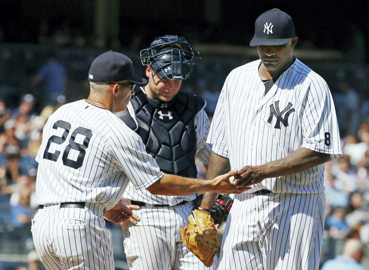 Yankees manager Joe Girardi takes the ball from CC Sabathia in the seventh inning on Sunday.