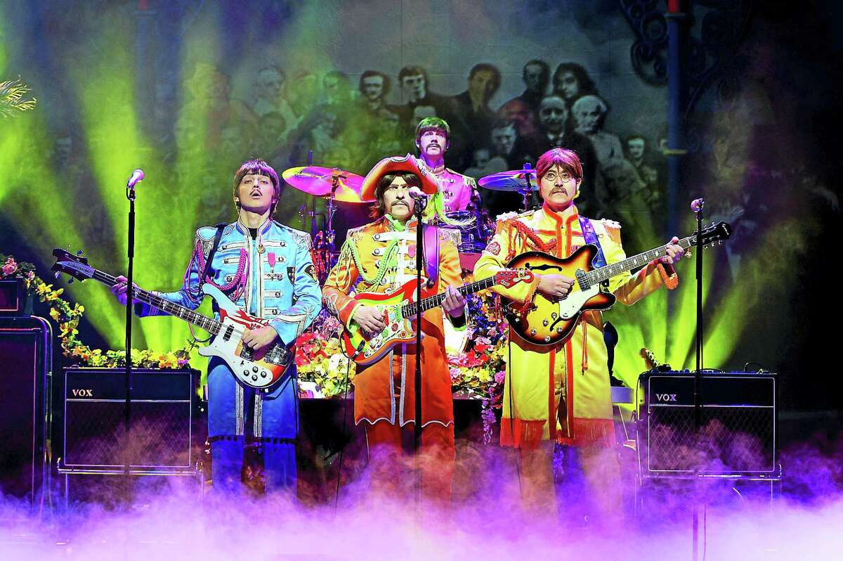 """""""Let It Be"""" in the Sgt. Pepper costumes."""