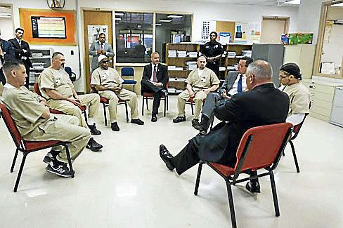Gov. Dannel P. Malloy and Corrections Commissioner Scott Semple talk to inmates in May.