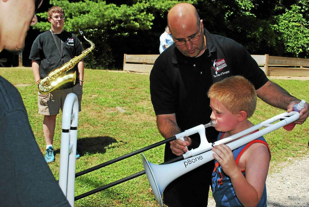 Campers and staff at Camp Moe enjoyed a surprise concert put on by the Torrington High School band Wednesday.