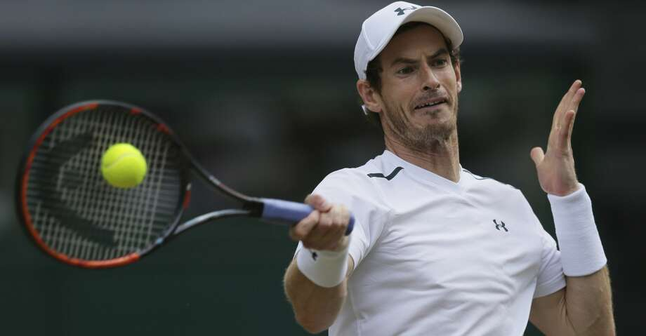 FILE -  This July 12, 2017 file photo shows Britain's Andy Murray returning to Sam Querrey of the United States during their Men's Singles Quarterfinal Match at the Wimbledon Tennis Championships in London. Murray surprisingly announced his withdrawal from the U.S. Open on Saturday, Aug. 26, 2017 because of a hip injury. (AP Photo/Tim Ireland, file) Photo: Tim Ireland/Associated Press