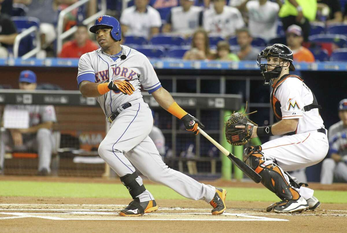 New York Mets batter Yoenis Cespedes hits a first inning double in front of Miami Marlins catcher J.T. Realmuto.