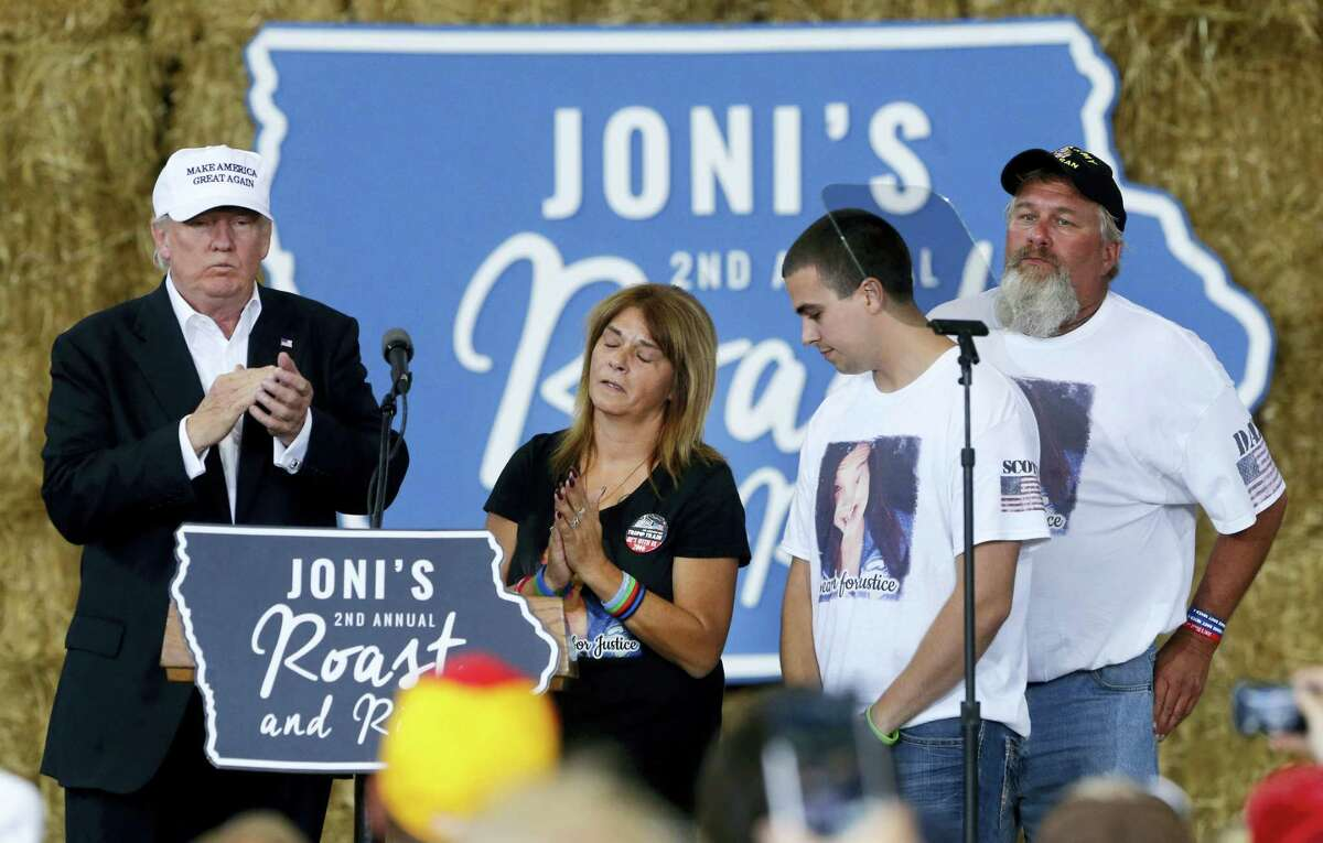 Republican presidential candidate Donald Trump shares the stage with the family of Sarah Root at Joni's Roast and Ride at the Iowa State Fairgrounds, in Des Moines, Iowa on Aug. 27, 2016. Second left is Sarah's mother, Michelle Root, brother Scott Root, and father Scott Bernhardt. Sarah Root was killed earlier this year after her car was hit by another. The driver, who was drunk, was a reportedly Honduran immigrant living in the country illegally.
