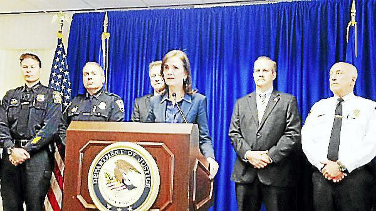 U.S. Attorney Deidre Daly, center, is joined by Hamden Police Chief Thomas Wydra, Torrington Police Chief Michael Maniago, Deputy Chief State's Attorney Leonard Boyle, DEA Assistant Special Agent in Charge Brian Boyle and East Hartford Deputy Chief Beau Thurnauer.