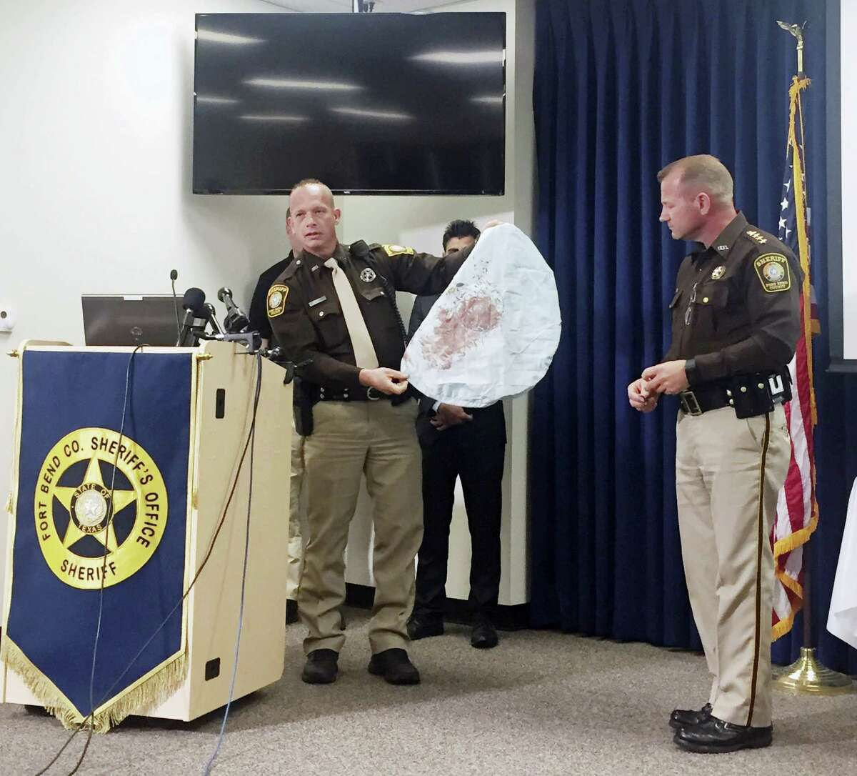 Deputy Danny Beckworth, who investigated the crash site, displays part of a defective airbag believed to have killed 17-year-old Huma Hanif during a news conference April 7 in Houston. The brother of a 17-year-old Texas girl who was killed last week when an exploding Takata air bag sent a shard of metal into her neck said he never received a recall notice about his 2002 Honda Civic.