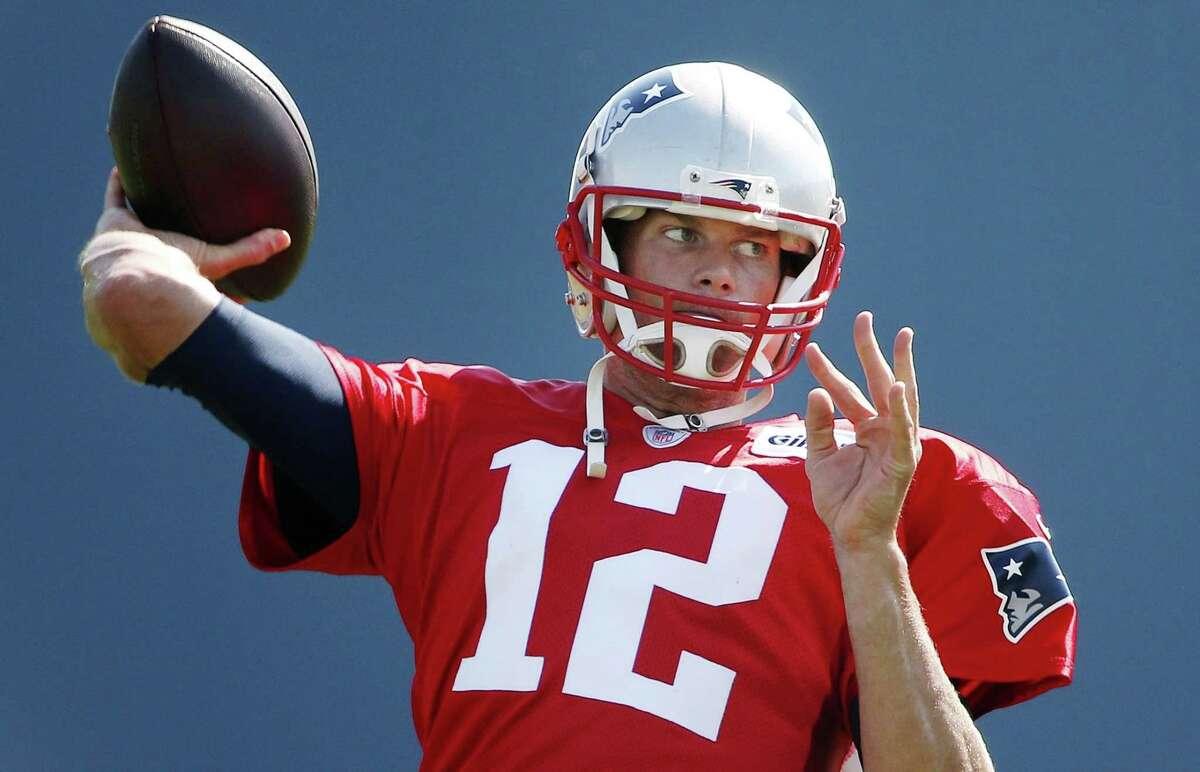 New England Patriots quarterback Tom Brady passes during training camp on Saturday in Foxborough, Mass.