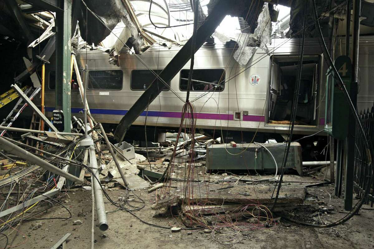 This Oct. 1, 2016, file photo provided by the National Transportation Safety Board shows damage done to the Hoboken Terminal in Hoboken, N.J., after the Sept. 29 commuter train crash. Lawmakers investigating September's deadly New Jersey Transit train crash could finally get a chance to question top agency officials who skipped out on an oversight hearing last month. NJ Transit says new executive director Steve Santoro and other key leaders will testify before the legislative committee on Friday, Nov. 4, 2016.