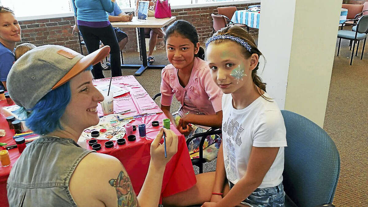 N.F. Ambery photo Abby Foulds, 10, of Torrington gets her face painted.