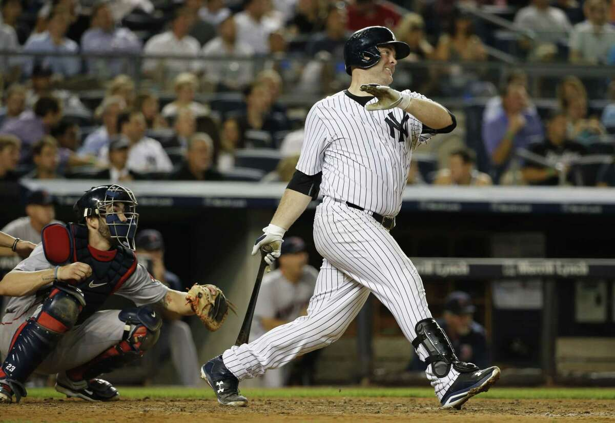 The Yankees' Brian McCann watches a sixth-inning RBI double against the Boston Red Sox on Tuesday. McCann added a three-run homer in the Yankees' 13-3 win.