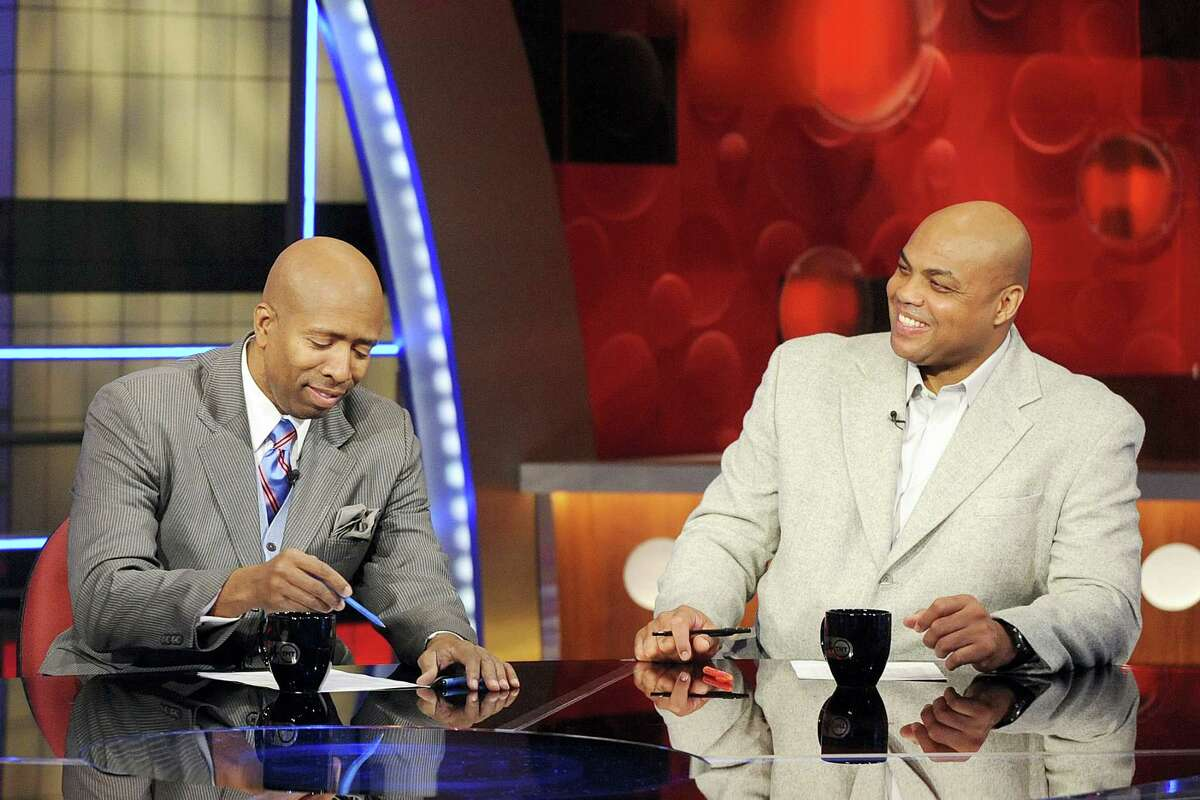 Basketball analysts Kenny Smith, left, and Charles Barkley are shown on the set at TNT studios in Atlanta. With eight years left on their deal to broadcast the NCAA Tournament, CBS and Turner are tacking on another eight. The extension announced Tuesday, April 12, 2016 goes all the way through 2032.