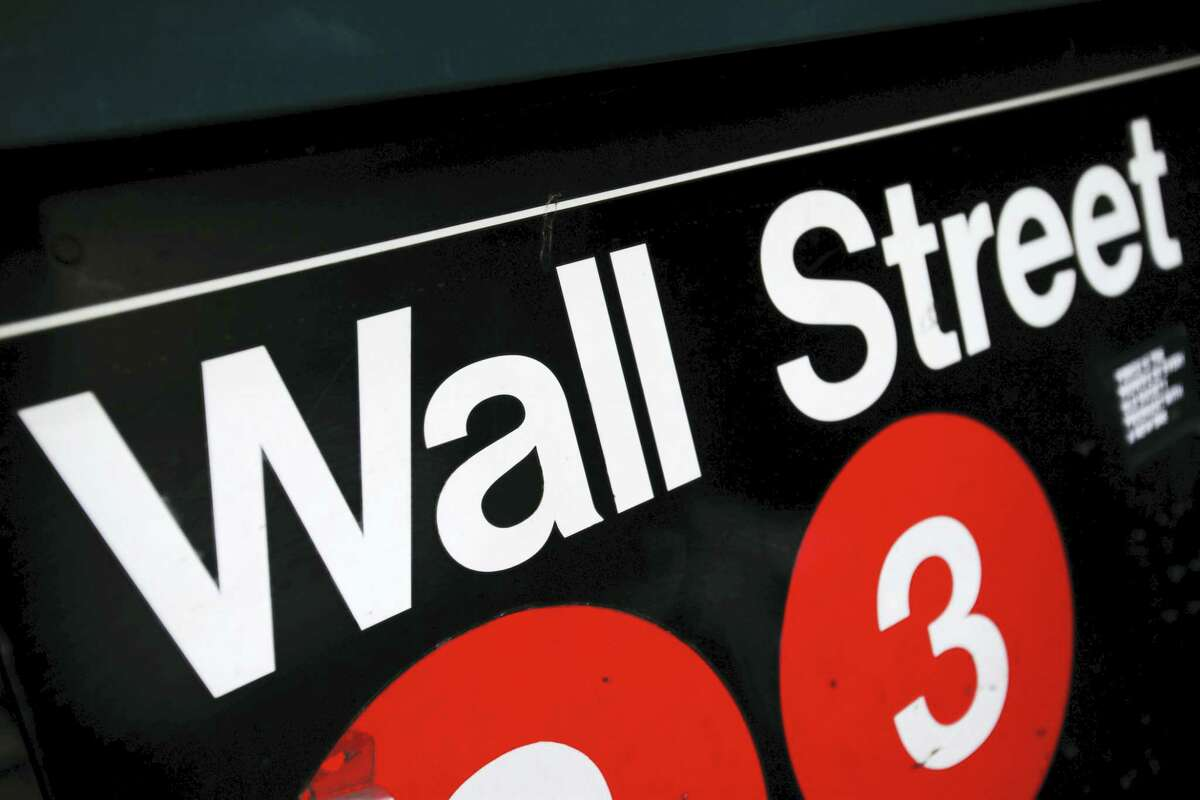FILE - This Jan. 4, 2010 file photo shows an entrance to a Wall Street subway station in New York. Shares fell Friday, Nov. 4, 2016, in Europe and Asia as nervous investors fretted over the potential outcome of next week's nail-bitingly close U.S. presidential election. Investors also were awaiting the release of U.S. employment data.