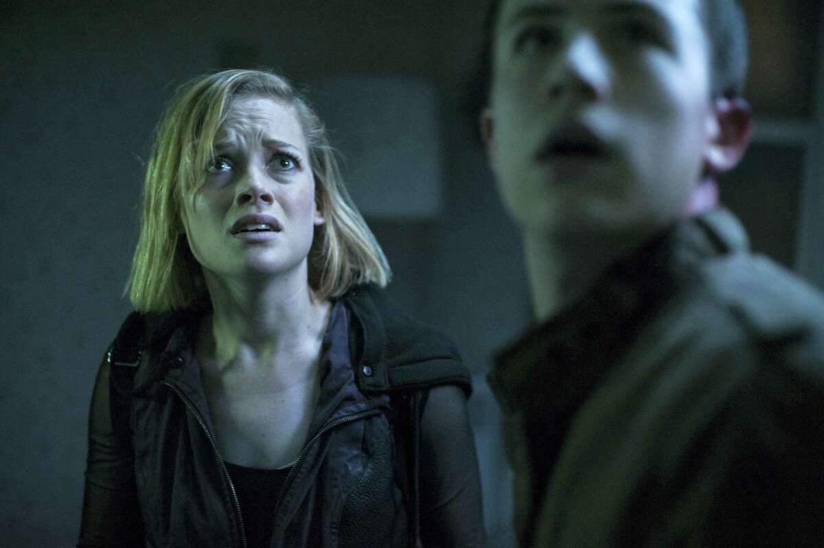 """This undated file image released by Sony Pictures shows Jane Levy, left, and Dylan Minnette in a scene from """"Dont Breathe."""" According to studio estimateson Aug. 28, 2016, audiences turned out in droves for the late summer thriller, which brought in $26.1 million."""