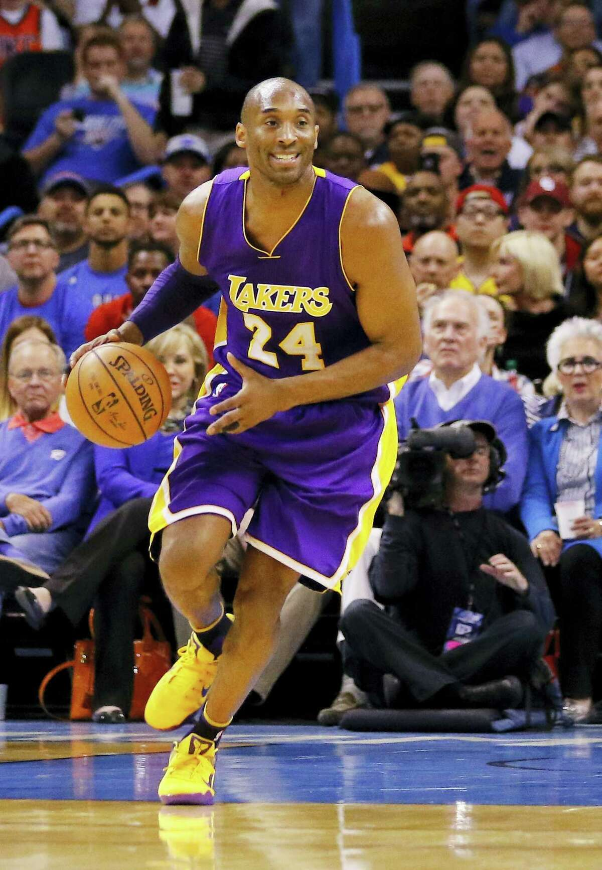 Los Angeles Lakers forward Kobe Bryant drives down the court during a recent game.