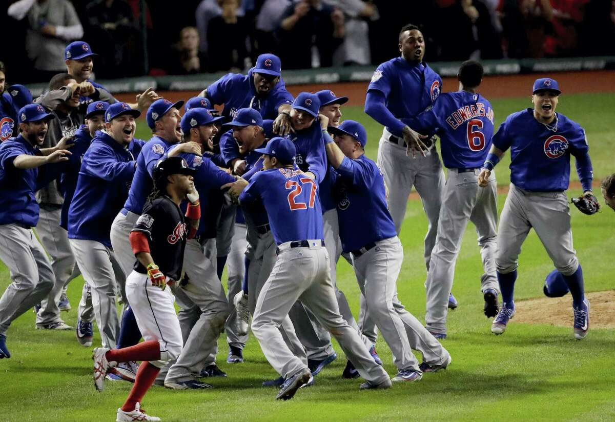 The Chicago Cubs celebrate after Game 7 of the World Series in Cleveland. The Cubs won 8-7 in 10 innings to win the series 4-3 and clinch their first world championship since 1908.