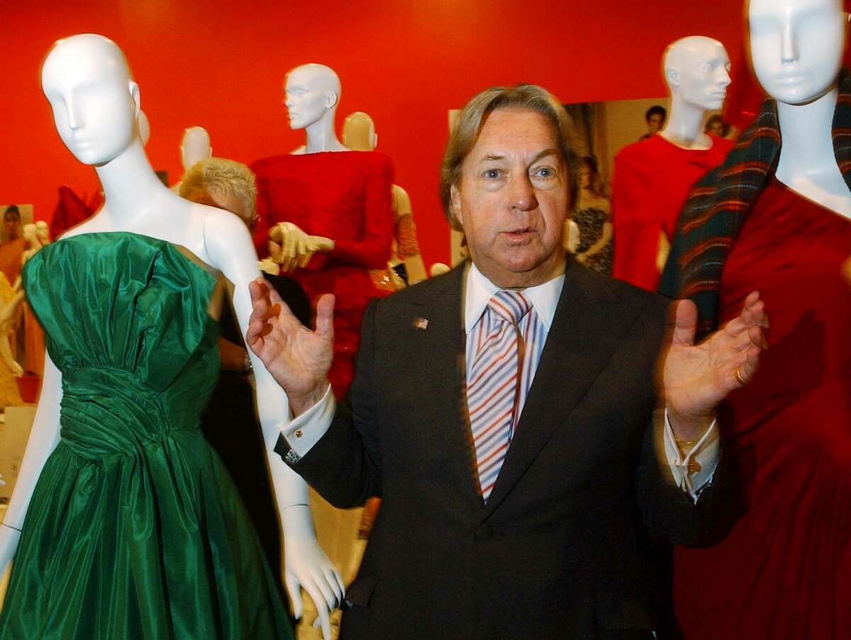 In this Oct. 10, 2002 photo, fashion designer Arnold Scaasi talks about his designs at the Fashion Institute of Technology in New York. Scaasi, whose flamboyant creations adorned first ladies, movie stars and socialites, died Aug. 4, 2015 at New York-Presbyterian Hospital of cardiac arrest. He was 85.
