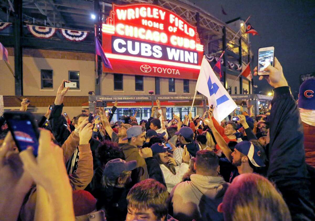 Cubs fans celebrate in front of Wrigley Field in Chicago.