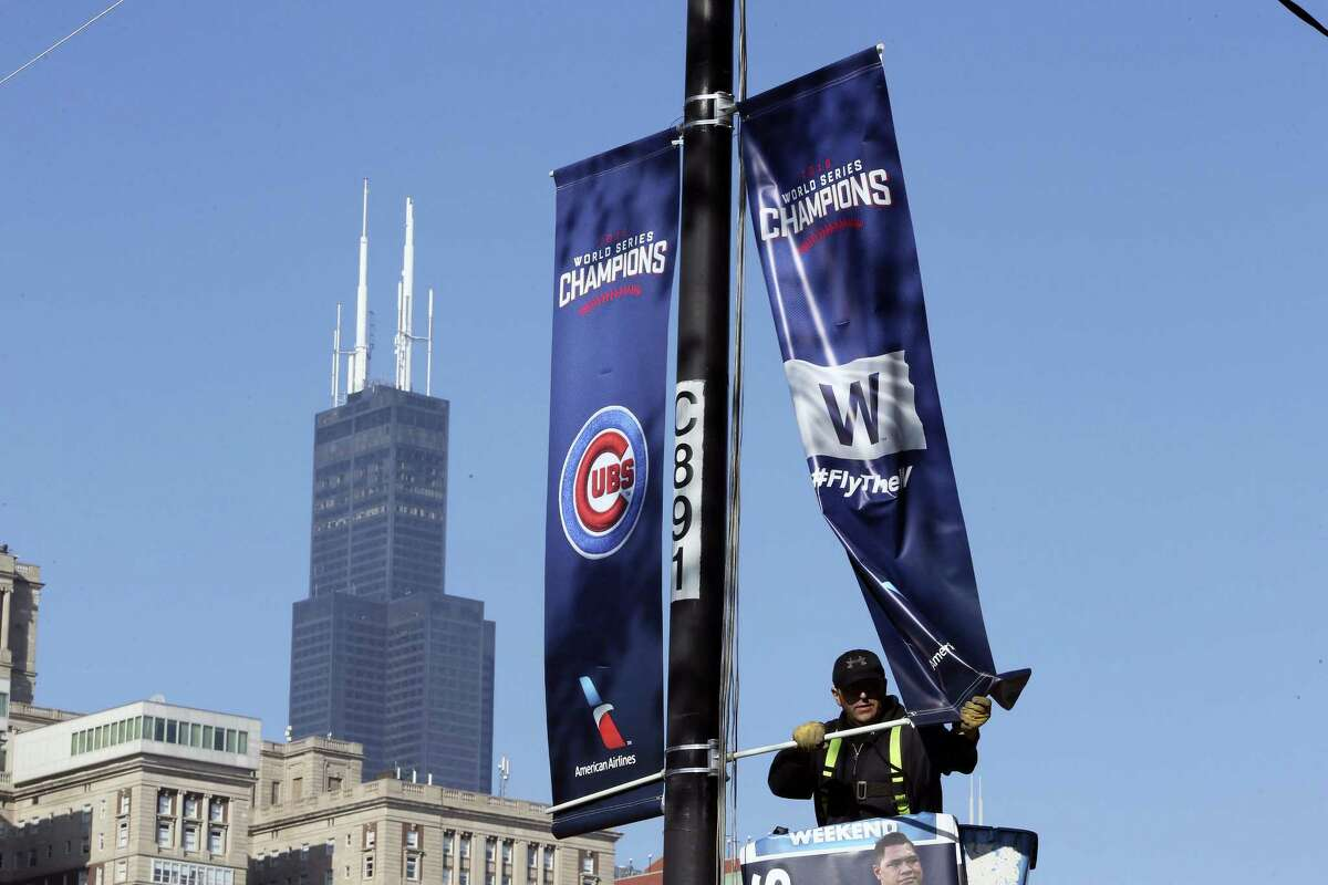 Chicago Cubs banners are installed in preparation for the parade and rally to celebrate the Cubs World series victory.