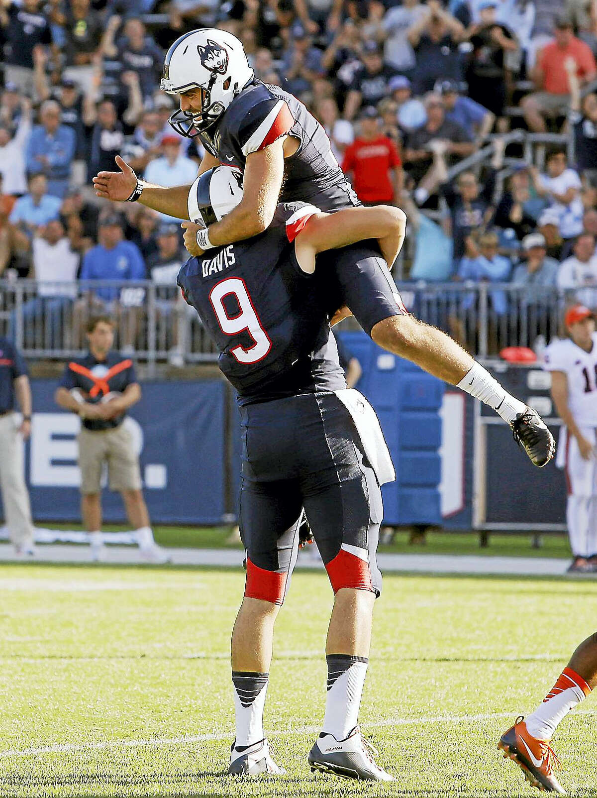 UConn placekicker Bobby Puyol, top, was named to the CoSIDA Academic District 1 team.