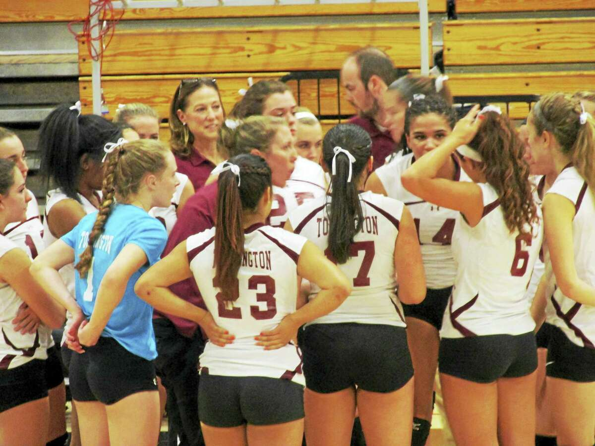 Photo by Peter WallaceTorrington Coach Christine Gamari pushes her team into one final lap before capturing the Naugatuck Valley League volleyball championship.