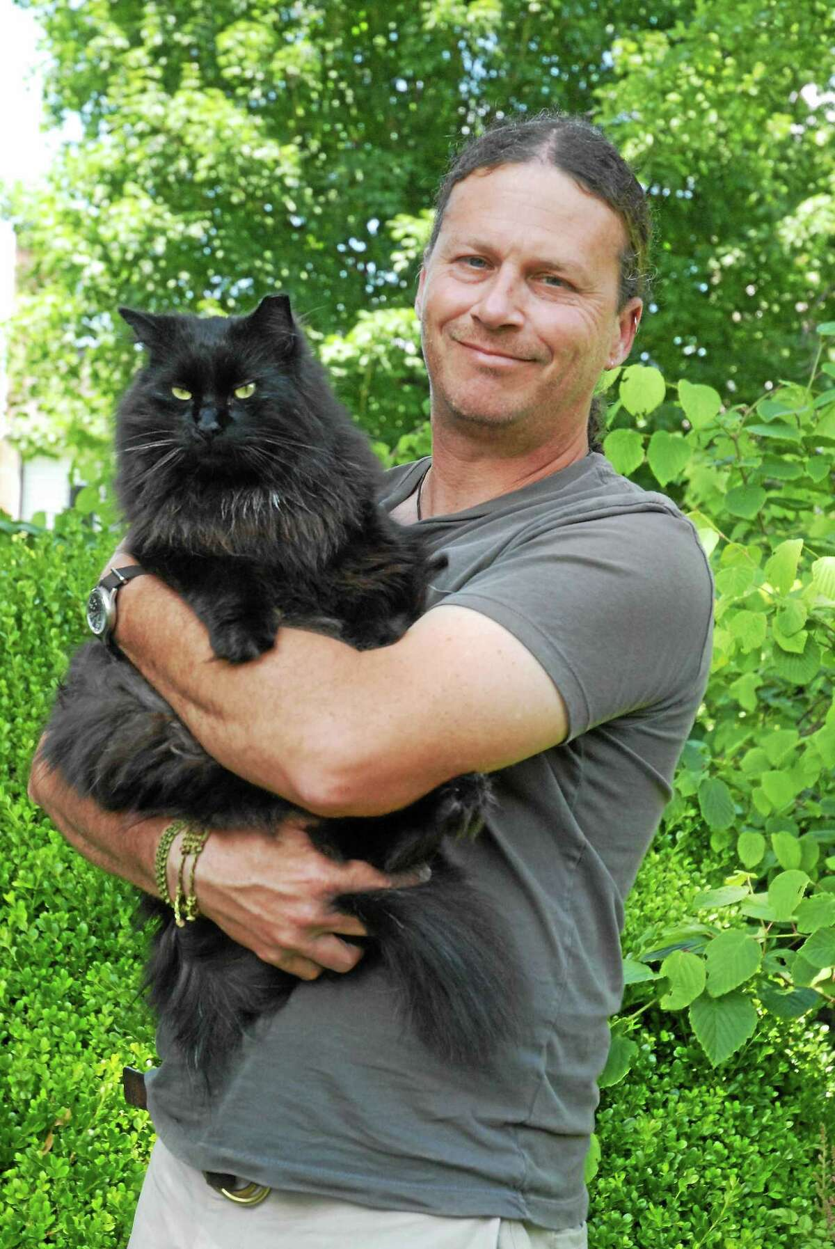 Rob Girard with Leo, the rescue garden cat.